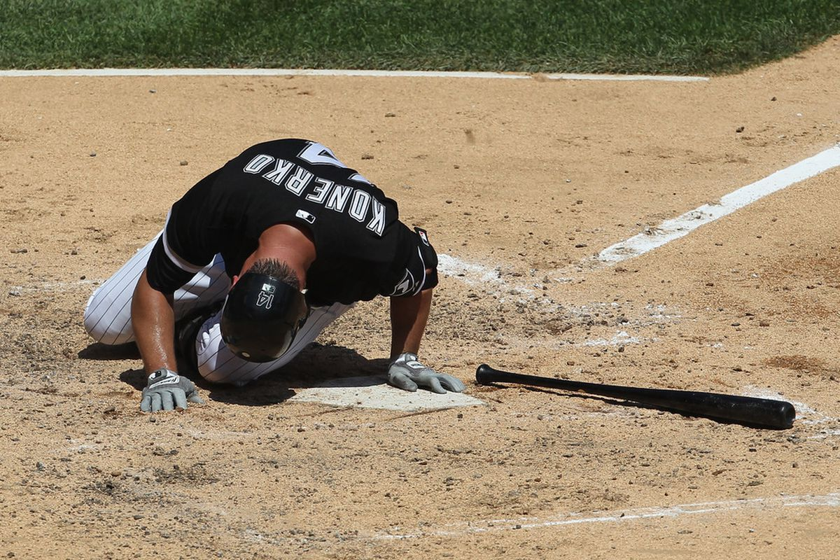CHICAGO, IL - JULY 31: Paul Konerko #14 of the Chicago White Sox falls to the dirt after being hit in the calf by a pitch against the Boston Red Sox at U.S. Cellular Field on July 31, 2011 in Chicago, Illinois. (Photo by Jonathan Daniel/Getty Images)