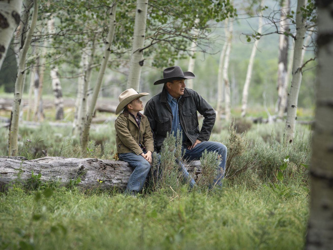 """Brecken Merrill as Tate Dutton, left, and Kevin Costner as John Dutton in an episode of the third season of """"Yellowstone."""""""