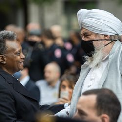 Chicago Mayor Lori Lightfoot shakes hands with Shiva Singh Khalsa, minister of Sikh Dharma International, during the commemoration of the 20th anniversary of 9/11 at the Richard J. Daley Plaza in the Loop, Saturday morning, Sept. 11, 2021.