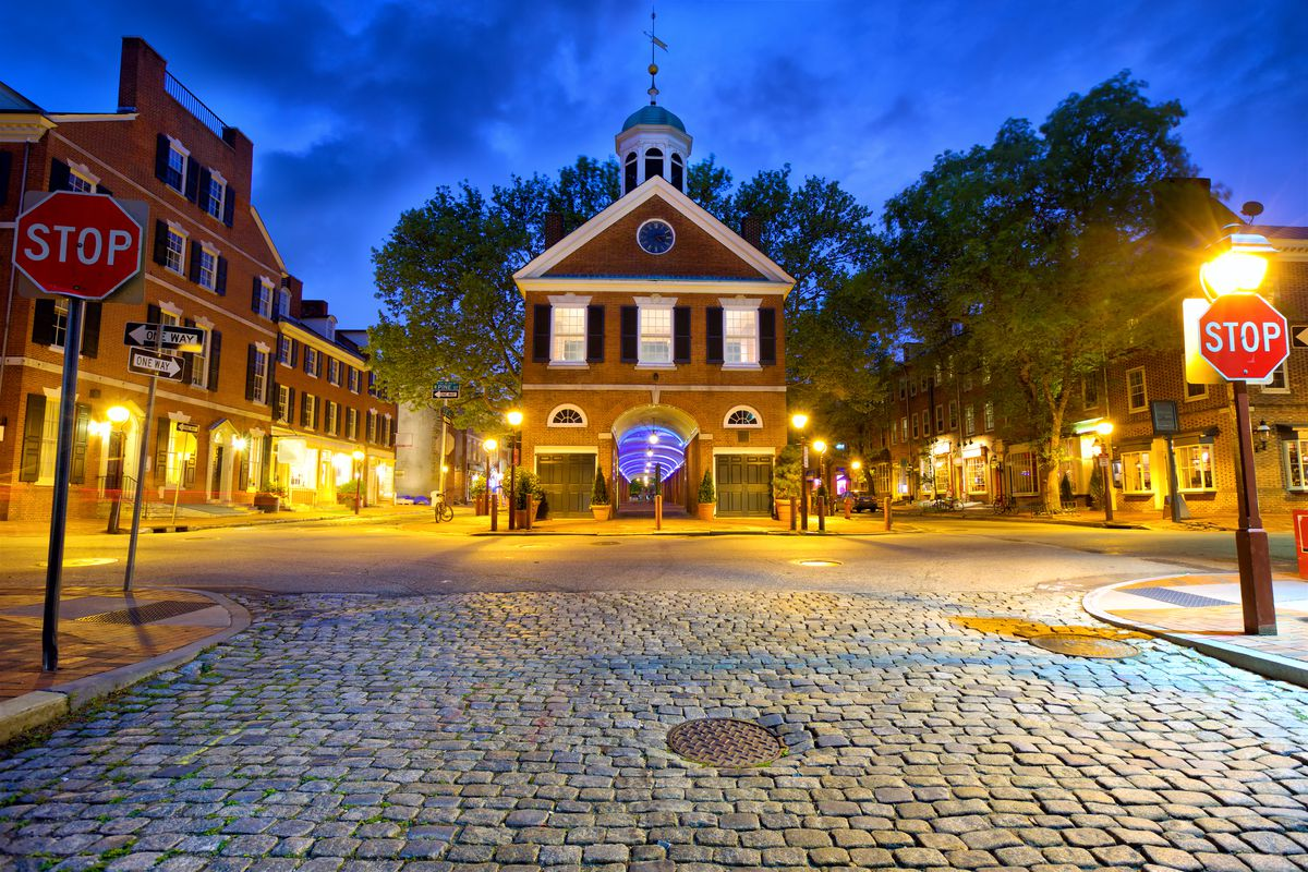 Headhouse Square in Society Hill, Philadelphia lit up at night.