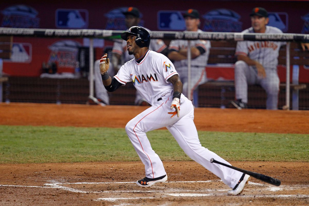 MIAMI, FL - MAY 26: Jose Reyes #7 of the Miami Marlins hits a single during a game against the San Francisco Giants at Marlins Park on May 26, 2012 in Miami, Florida.  (Photo by Sarah Glenn/Getty Images)