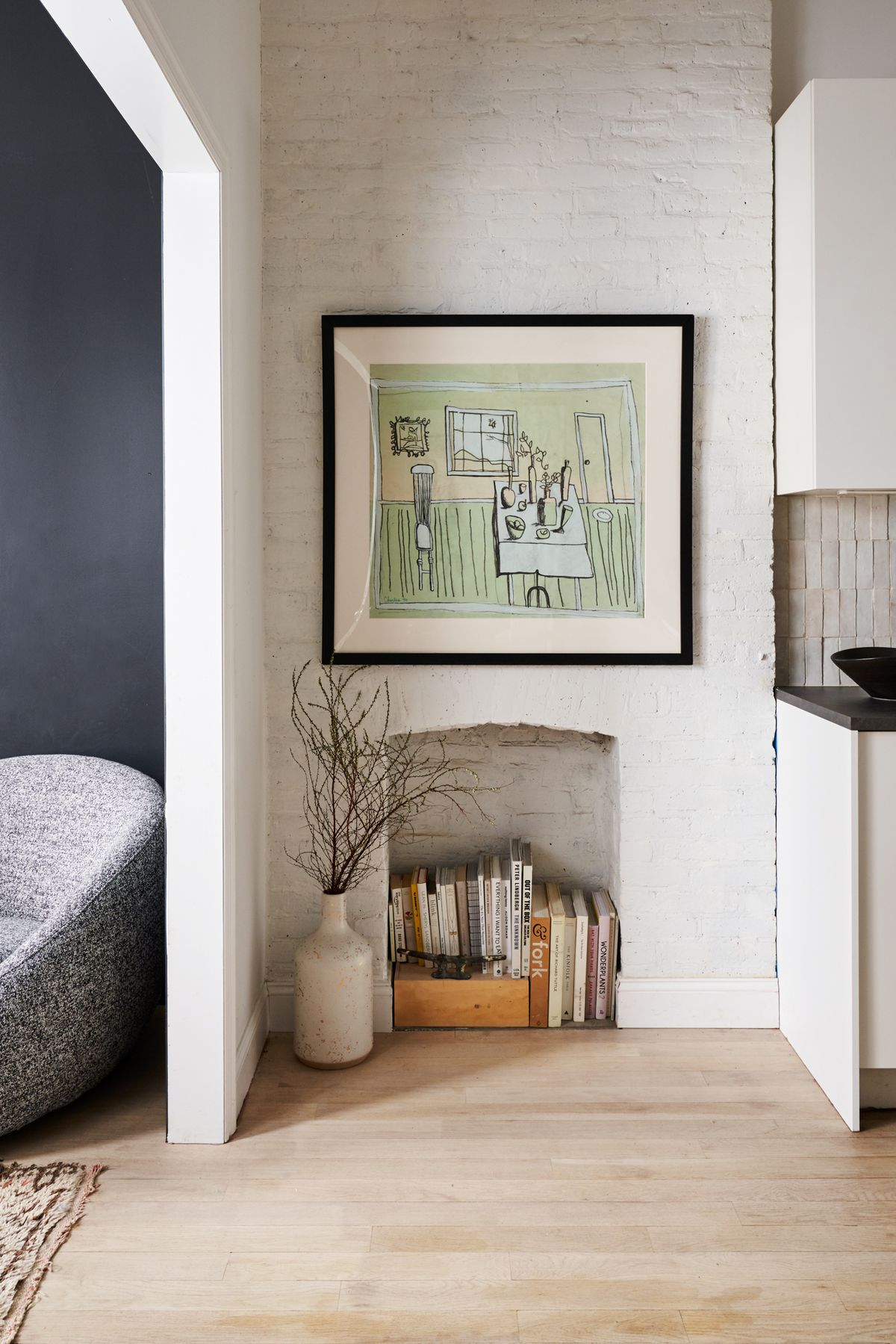 A nook with white exposed brick.