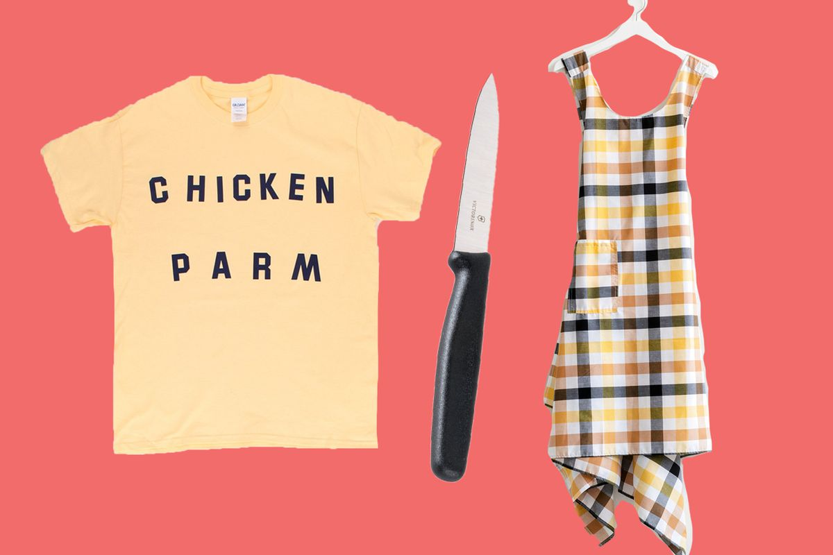 A Chicken Parm T-shirt, a Victorinox paring knife, and a checkered apron handing on a hanger