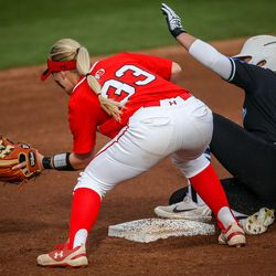 In the first inning, BYU outfielder Rylee Jensen (2) slides safely onto second base ahead of the tag by Utah shortstop Abby Robertson (33) as the University of Utah hosts Brigham Young University at Duke Stadium in Salt Lake City on Wednesday, April 18, 2018.