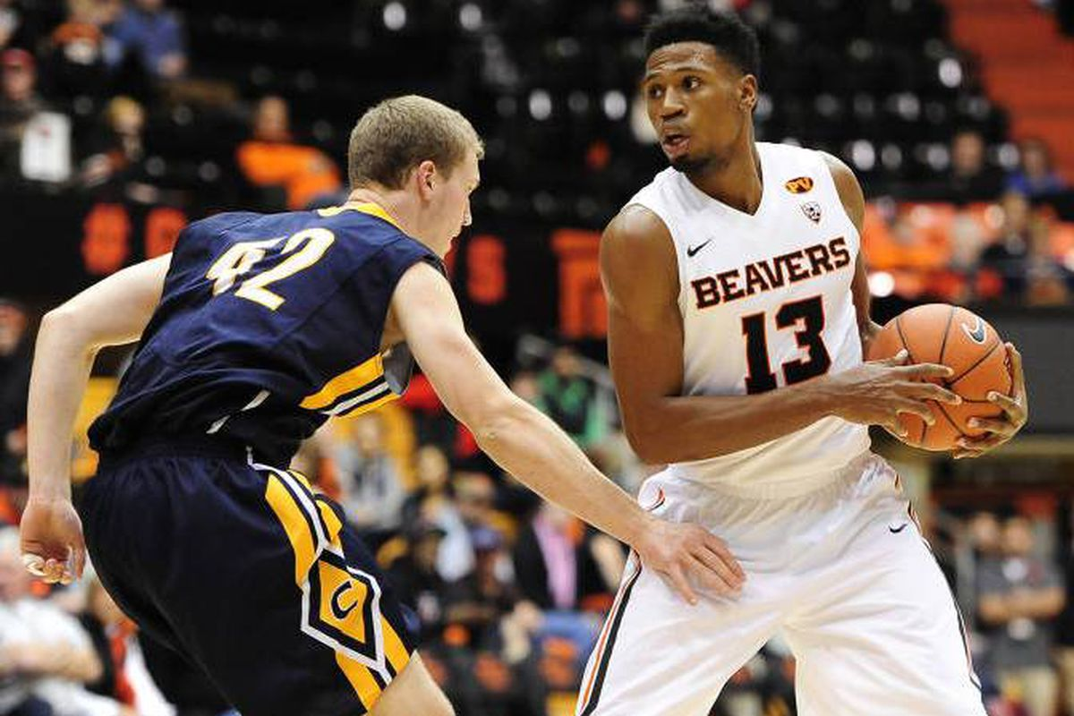 Langston Morris-Walker works past Corban's Cyrus Ward, and helped lead the Beavers past the Warriors.