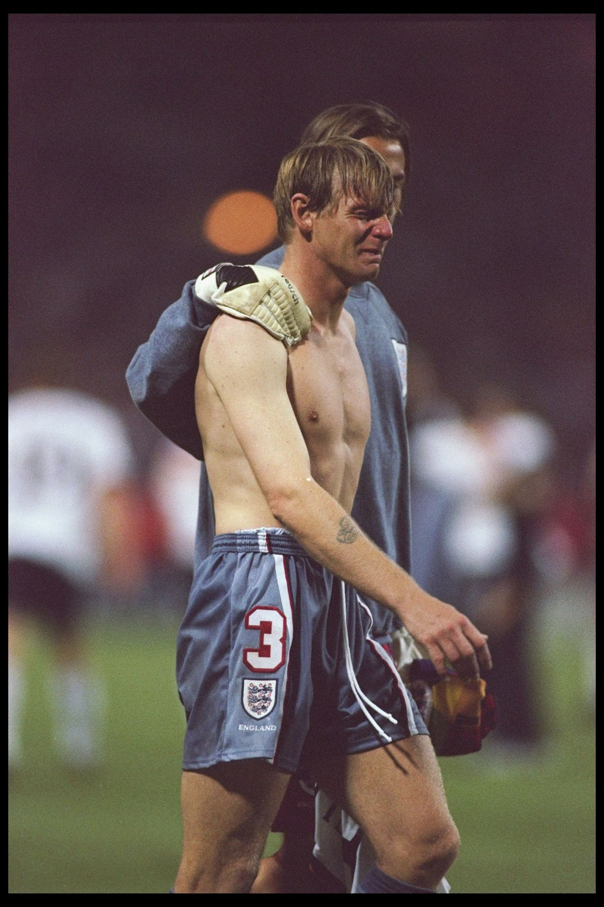 Stuart Pearce of England is consoled