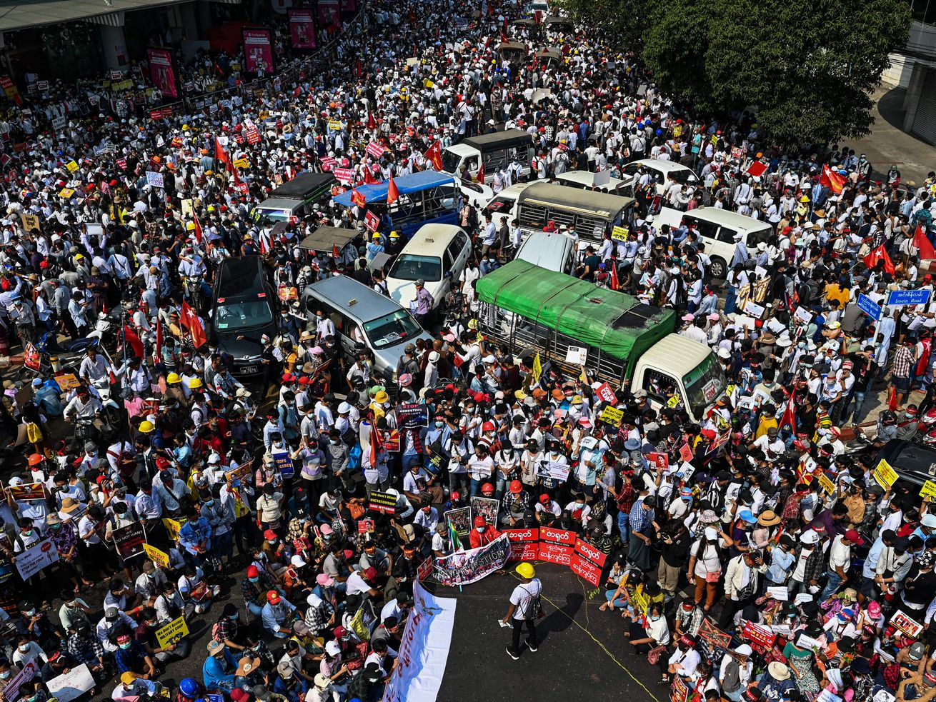 Aerial photo of a street crowded with protesters.