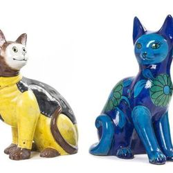 These glazed sphinxes are sure to brighten any room, although they might not land on their feet if they fall.