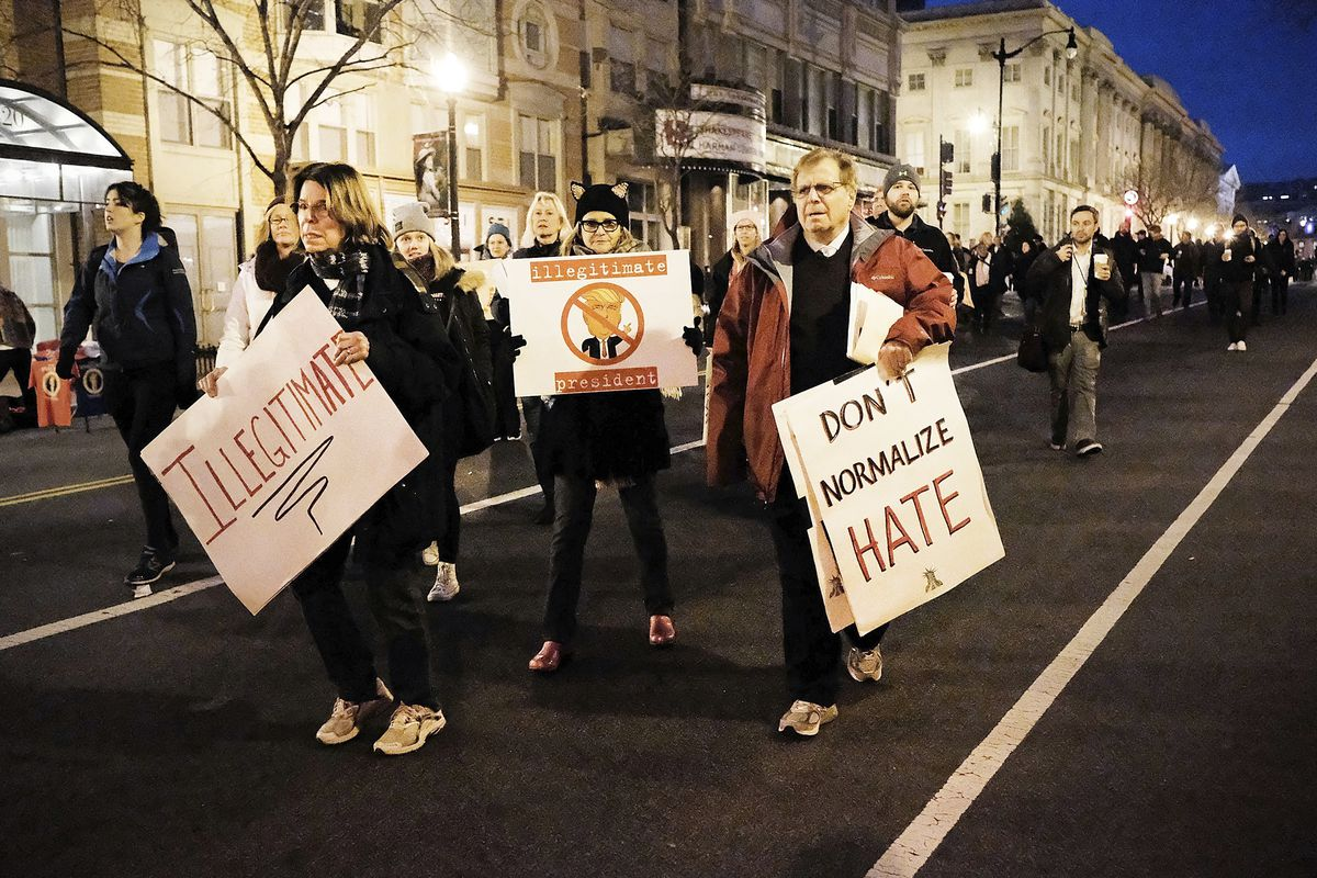 Trump protesters head to the National Mall on January 20, 2017 in Washington, DC.