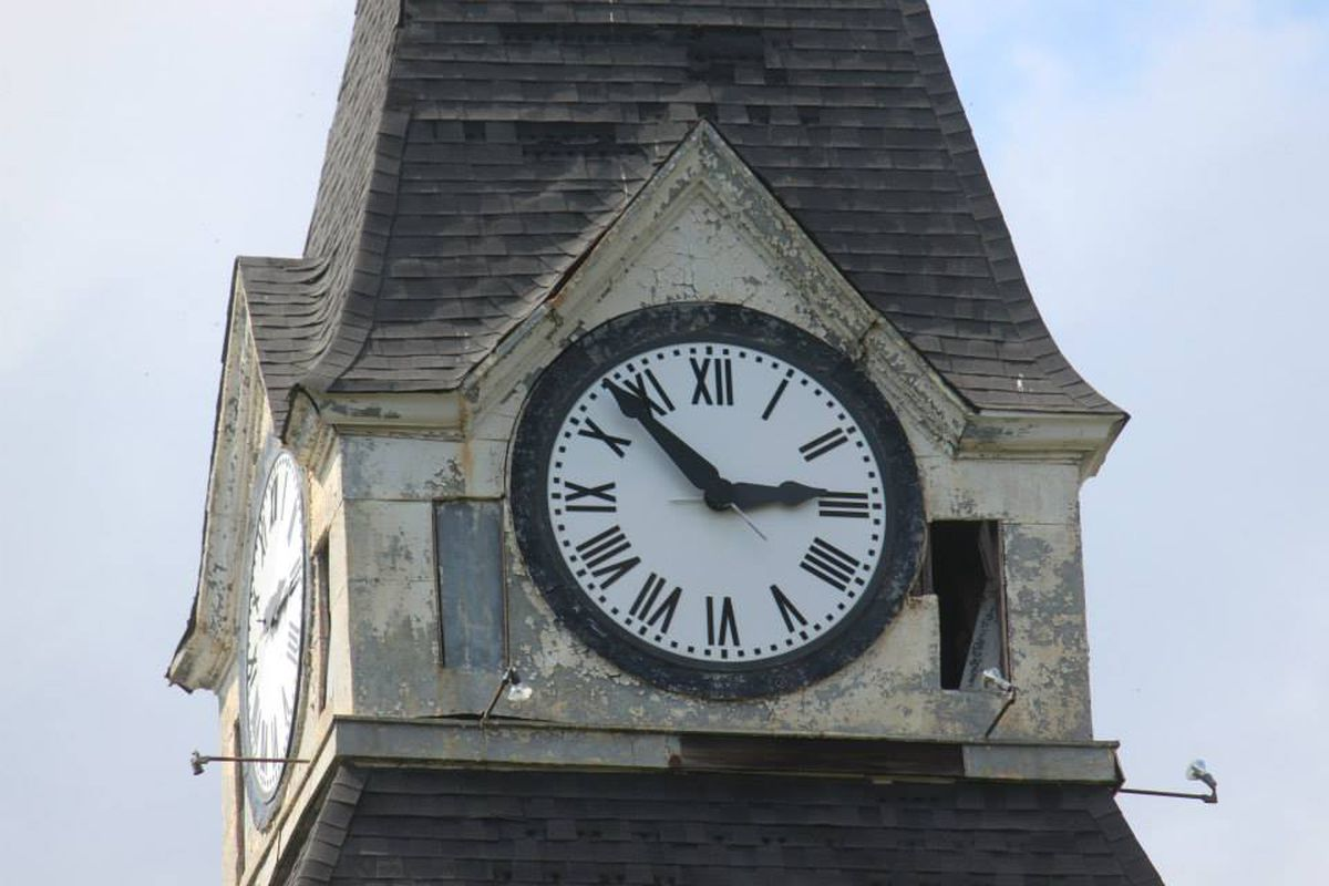 A close-up of the iconic clock tower atop Morris Brown's Fountain Hall.