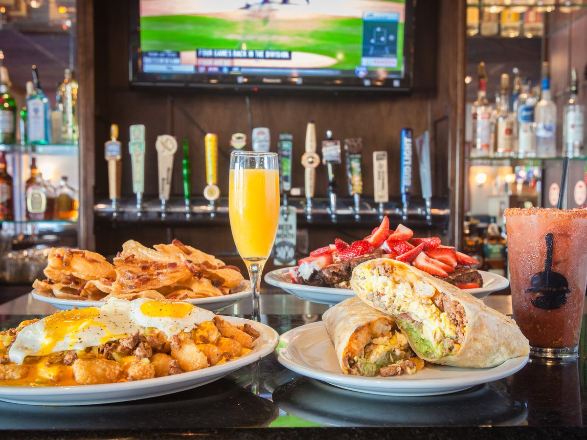 Mimosa and breakfast dishes