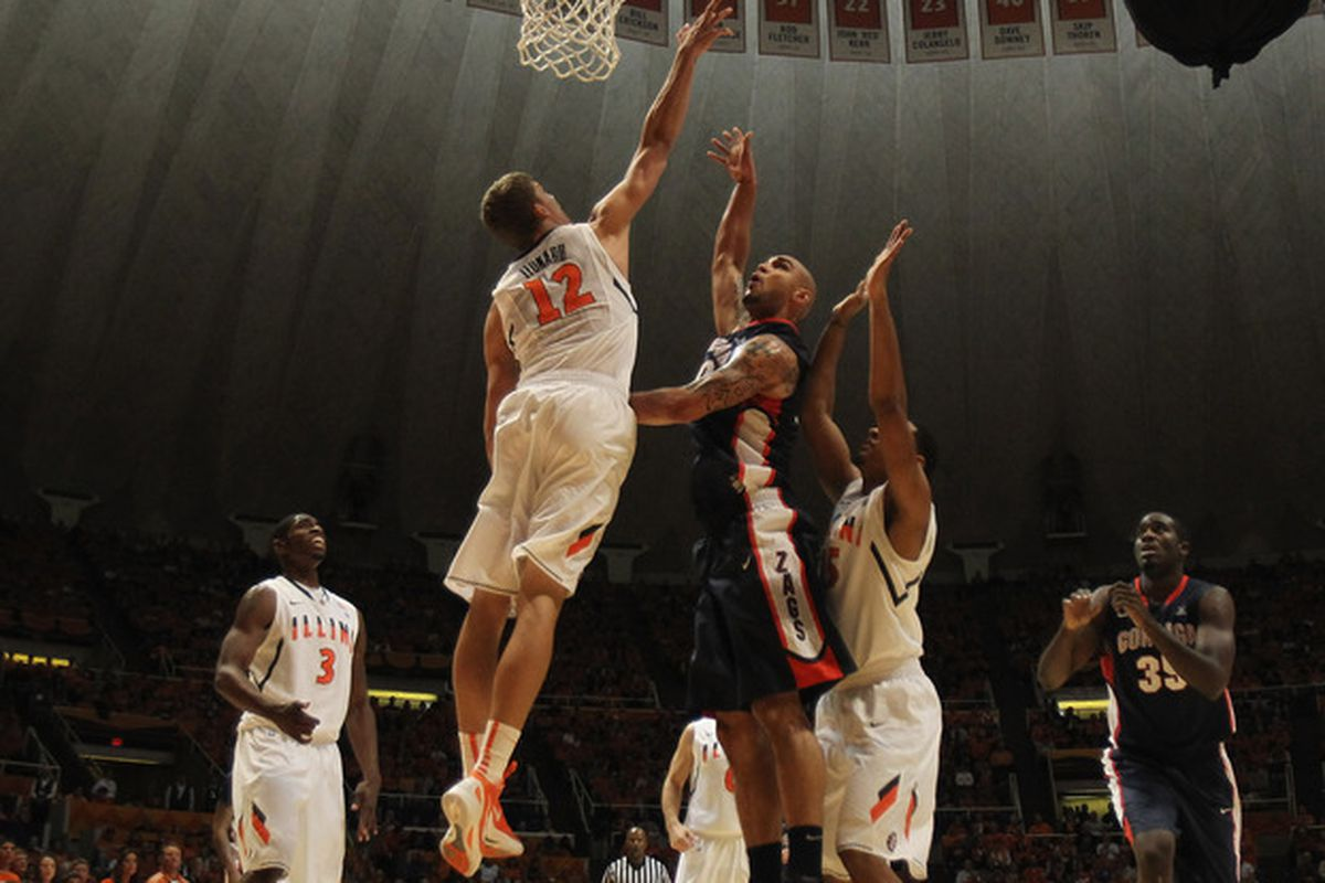 CHAMPAIGN, IL - DECEMBER 03: Meyers Leonard #12 of the Illinois Fighting Illini blocks a shot by Robert Sacre #00 of the Gonzaga Bulldogs at Assembly Hall on December 3, 2011 in Champaign, Illinois. (Photo by Jonathan Daniel/Getty Images)
