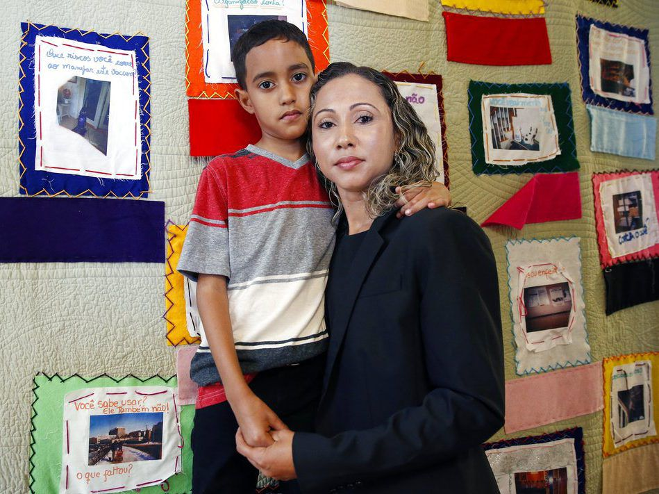 A Brazilian mother, who asked to be identified only as W.R. poses with her 9 year-old son A.R. after speaking during a news conference at the Brazilian Worker Center in Boston on July, 16, 2018. The mother spoke to reporters Monday after she was reunited
