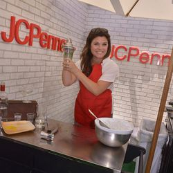 Former <i>Saved By the Bell</i> star Tiffani (Amber!) Thiessen demonstrates her mixing skills during a cooking class. Photo via Super Saturday.