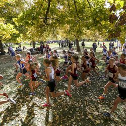 The mass start of runners rounds the first corner in the 4A Girls State Cross-Country Championships at Sugar House Park in Salt Lake City on Wednesday, Oct. 23, 2019.