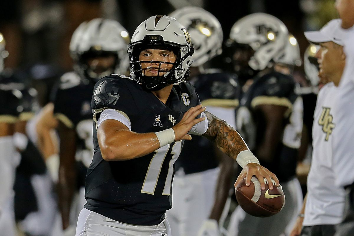 Dillon Gabriel of the UCF Knights warms up against the Boise State Broncos at the Bounce House on September 2, 2021 in Orlando, Florida.