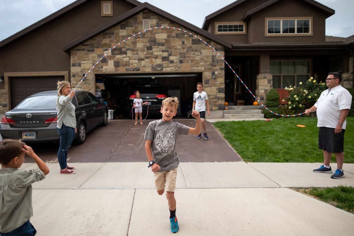 Ashley and Ethan Felix play outside with their children, from left, Briggs, 4; Andi Lou, 6; Beau, 8; and Wyatt, 12, at their home in Provo on Tuesday, Oct. 5, 2021.