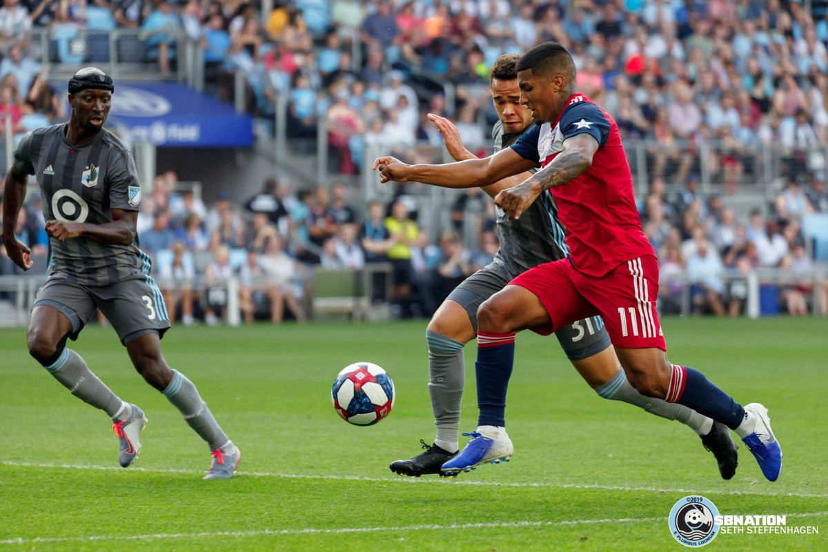July 13, 2019 - Saint Paul, Minnesota, United States - Minnesota United  midfielder Hassani Dotson (31) matches the stride of FC Dallas midfielder Santiago Mosquera (11) as they battle for the ball during the match at Allianz Field.