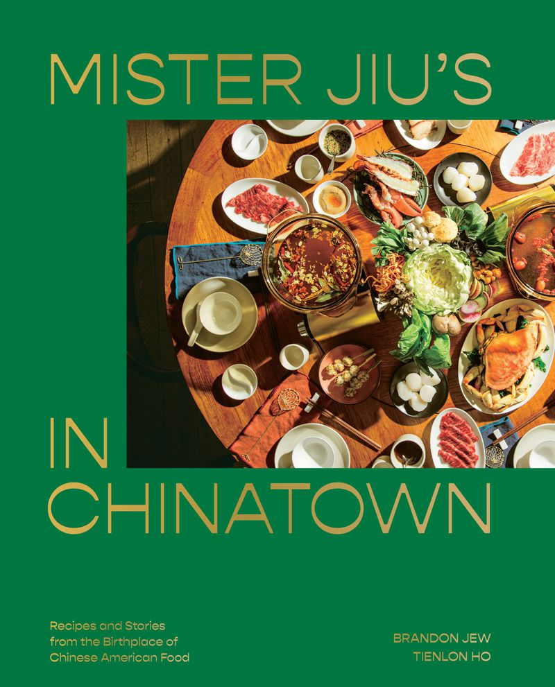 On the cover of Mister Jiu's Chinatown cookbook, a table is set with a feast.