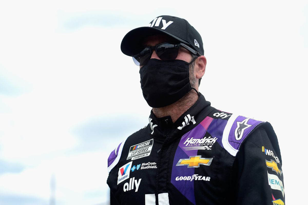 Jimmie Johnson, driver of the #48 Ally Chevrolet, walks on the grid prior to the NASCAR Cup Series Pocono 350 at Pocono Raceway on June 28, 2020 in Long Pond, Pennsylvania.