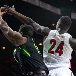 Arizona's Emmanuel Akot (24) tries to block a shot by Baylor during the Arizona-Baylor game in McKale Center on December 15 in Tucson, Ariz.