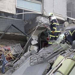 Emergency rescue teams search for victims in a collapsed building after a 6.4-magnitude earthquake in Tainan, Taiwan, Saturday, Feb. 6, 2016. The earthquake struck southern Taiwan early Saturday, toppling at least one high-rise residential building and trapping people inside. (AP Photo)