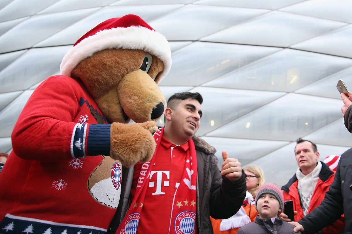 FC Bayern Muenchen Christmas Market MUNICH, GERMANY - DECEMBER 11: Berni, the FC Bayern club mascot poses with fans during the FC Bayern Muenchen Christmas Market at Allianz Arena on December 11, 2016 in Munich, Germany.