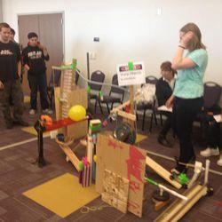 Northridge High School students demonstrate their Rube Goldberg machine to judges and spectators.
