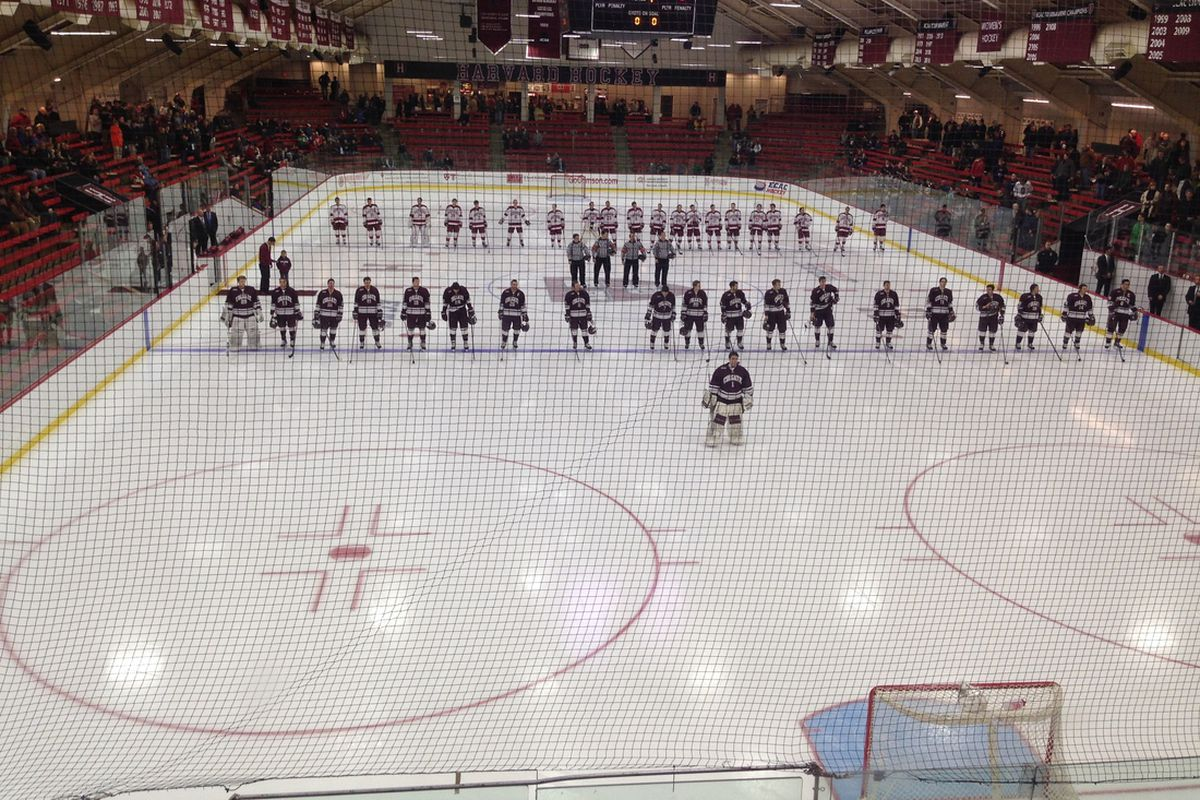 Colgate and Harvard players line up for the national anthem before their ECAC game on Saturday, Jan. 18, 2014.