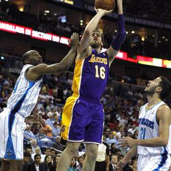 Los Angeles Lakers power forward Pau Gasol (16) shoots between New Orleans Hornets power forward Carl Landry, left, and point guard Greivis Vasquez (21) in the first half of an NBA basketball game in New Orleans, Monday, April 9, 2012.