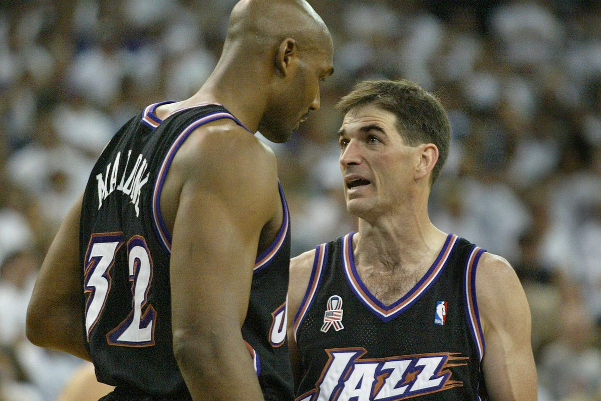 Karl Malone and John Stockton talk in the final minute as the Jazz lost the first game of the playoffs to the Kings, 89-86 in Sacramento, Calif. April 20, 2002. Photo by Tom Smart (Submission date: 04/20/2002)