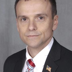 In a photo provided by the Arkansas Secretary of State's office, taken Feb. 24, 2012, Republican Congressional candidate John Cowart poses in Little Rock, Ark. Cowart and one other candidate in the race for Arkansas 4th Congressional district are veterans of the war in Afghanistan.