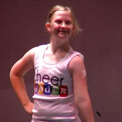 Lily Smith, a 14-year-old with Down syndrome, tried out for Eisenhower Junior High School's cheerleadering team and made the squad. She showed off her skills during a goodbye assembly Thursday, May 30, 2013.