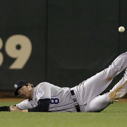 Colorado Rockies left fielder Charlie Blackmon (8) cannot make a diving catch on a fly ball by San Francisco Giants' Angel Pagan during the eighth inning of a baseball game on, Tuesday, Sept. 18, 2012 in San Francisco.  Pagan drove in a run with a triple on the play.