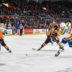 Syracuse Crunch Peter Abbandonato (17) fires the puck against Lehigh Valley Phantoms Andy Welinski (3) and Morgan Frost (23) in American Hockey League (AHL) action at the Upstate Medical University Arena in Syracuse, New York on Saturday, February 22, 2020. Syracuse won 2-1.