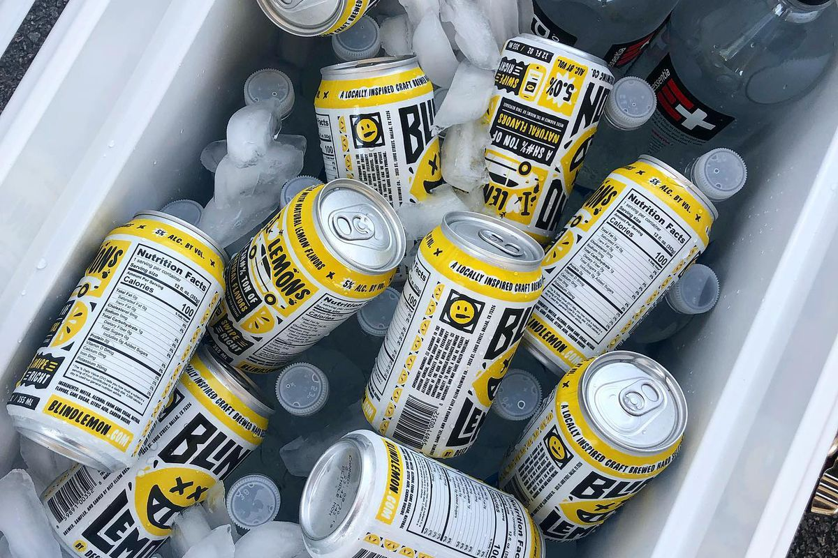 Cans of Blind Lemon spiked seltzer in a white cooler with ice