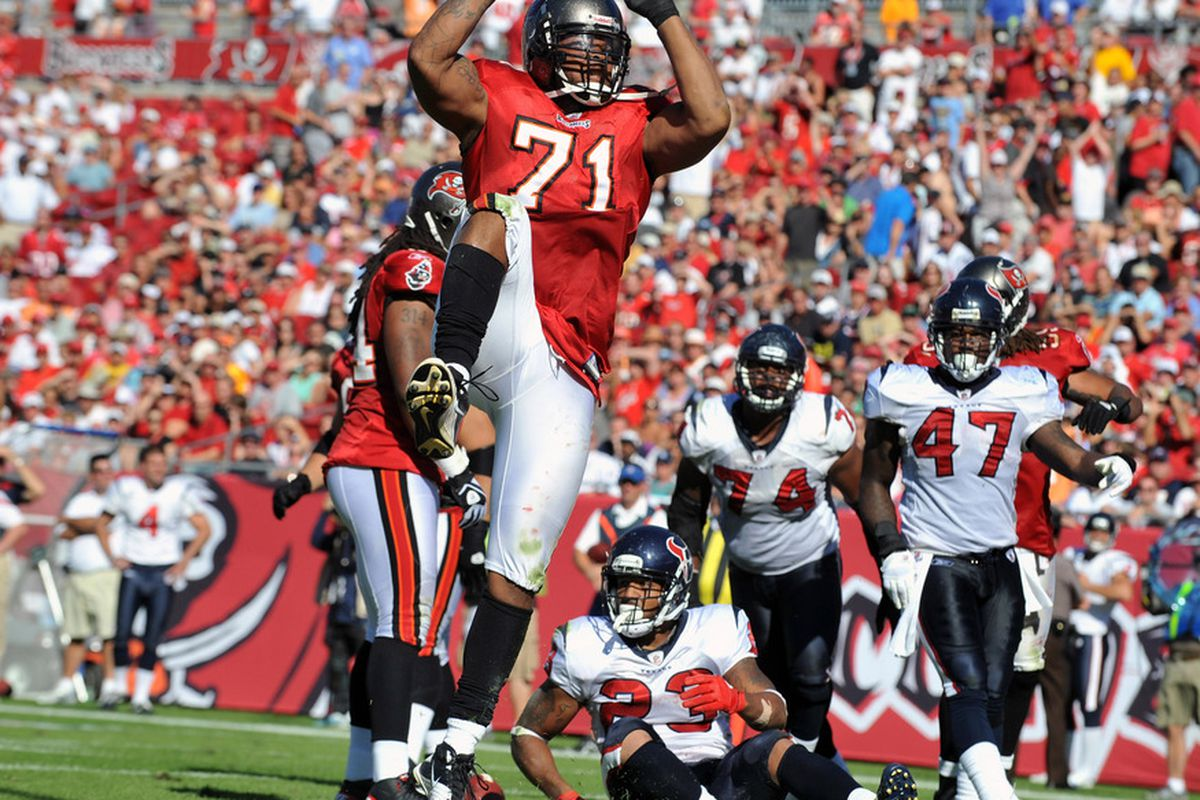 TAMPA, FL - NOVEMBER 13:  Defensive lineman Michael Bennett #71 of the Tampa Bay Buccaneers celebrates after a tackle against the Houston Texans November 13, 2011 at Raymond James Stadium in Tampa, Florida. (Photo by Al Messerschmidt/Getty Images)