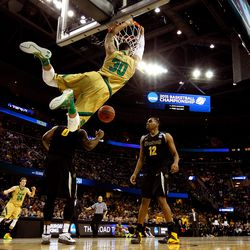 If you think I'm tired of posting photos of Zach dunking, think again.