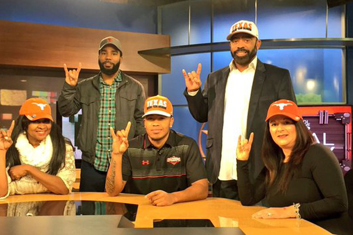 Eric Cuffee and his family after committing