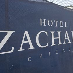 Hotel Zachary banner on the construction fence, along Addison Street