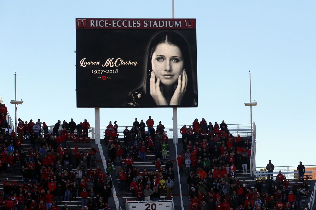 FILE - In this Nov. 10, 2018, file photo, a photograph of University of Utah student and track athlete Lauren McCluskey, who was fatally shot on campus, is projected on the video board before the start of an NCAA college football game between Oregon and U