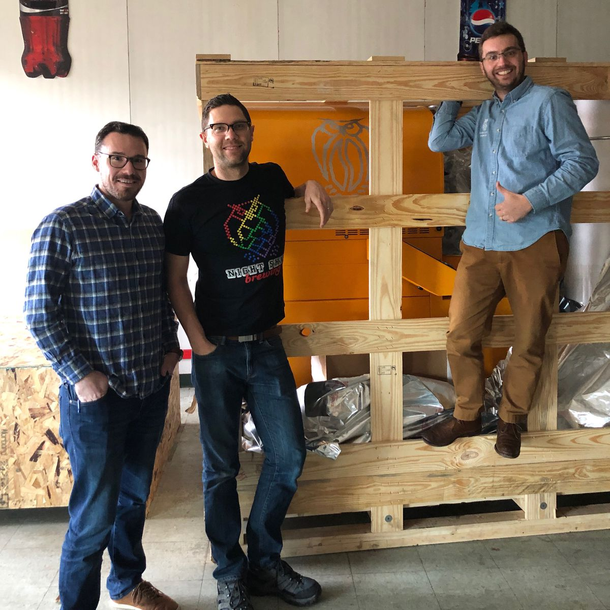 Night Shift founders Rob Burns, Michael Oxton, and Mike O'Mara with the roasting machine