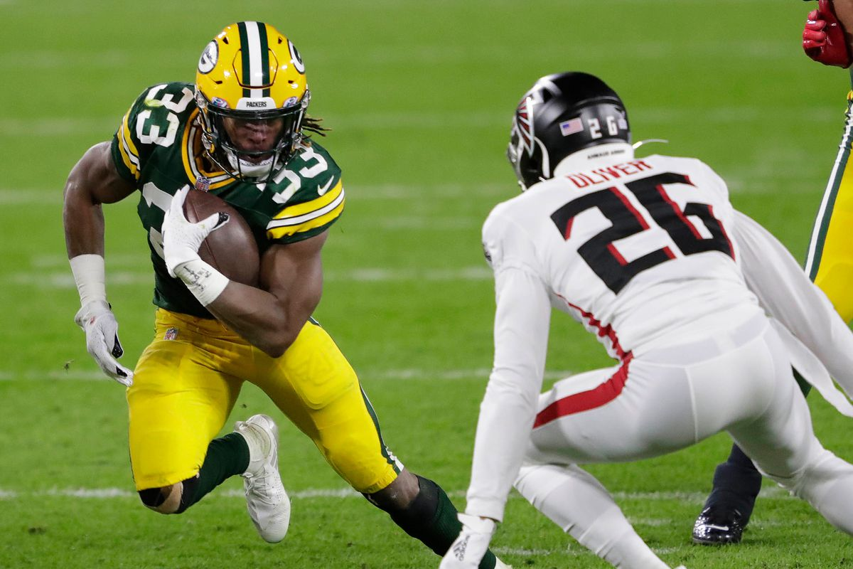 Green Bay Packers running back Aaron Jones tries to elude Atlanta Falcons cornerback Isaiah Oliver. Nfl Atlanta Falcons At Green Bay Packers