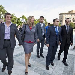 Arriving at the Supreme Court on a final day for decisions in two gay marriage cases are, from left, plaintiffs in the California Proposition 8 case, Kris Perry, her partner Sandy Stier, Jeff Zarrillo, and his partner Paul Katami, in Washington, Wednesday, June 26, 2013. (AP Photo/J. Scott Applewhite)
