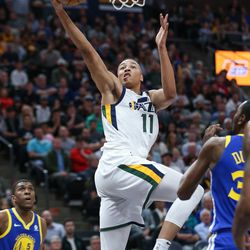 Utah Jazz guard Dante Exum (11) goes to the hoop during the game against the Golden State Warriors at Vivint Arena in Salt Lake City on Tuesday, April 10, 2018.