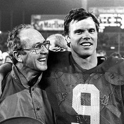 Jim McMahon Sr. is all smiles, as is his son, BYU quarterback Jim McMahon Jr., who threw the winning touchdown in the 1980 Holiday Bowl against SMU.