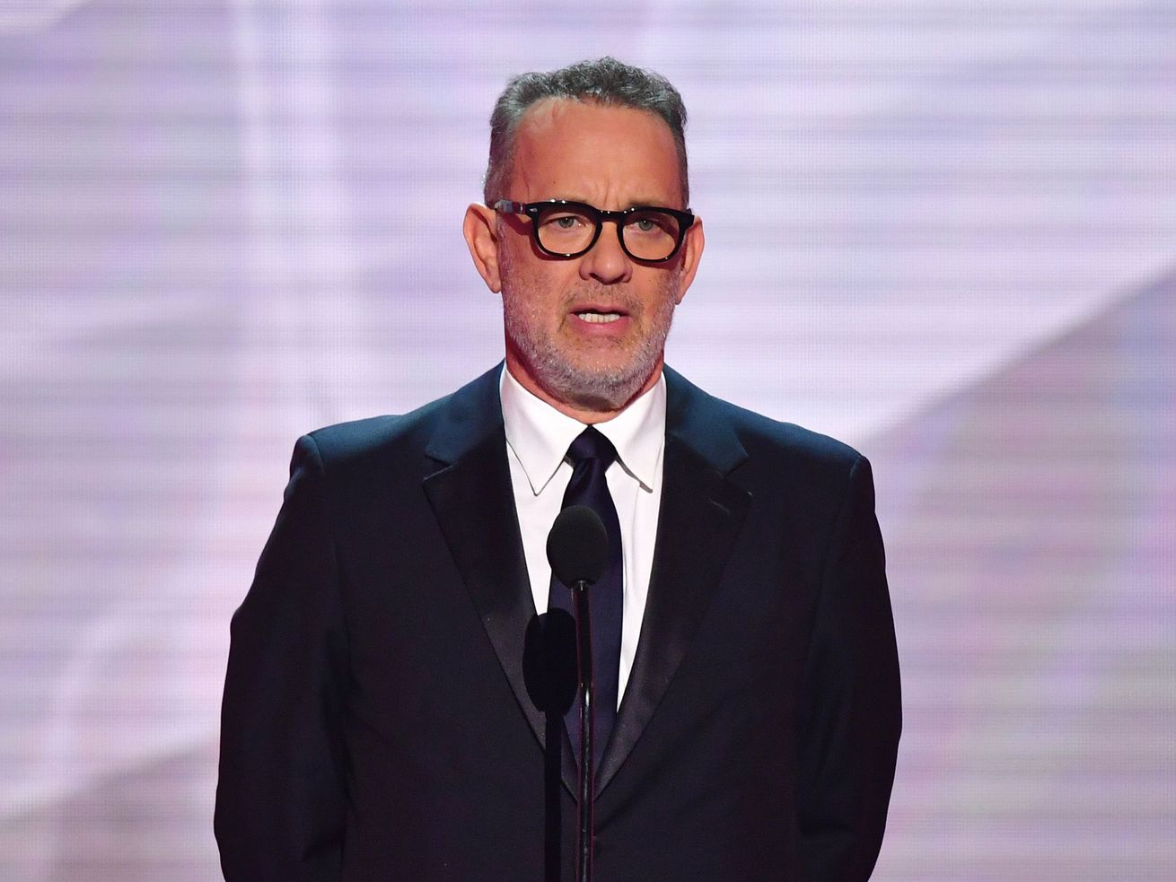 Actor Tom Hanks speaks onstage during the 25th Annual Screen Actors Guild Awards show in Los Angeles in 2019.