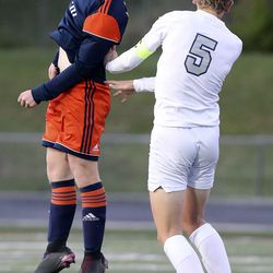 Mountain Crest's Ethan Tarr and Ridgeline's Luke Dustin reach for a header during the 4A boys soccer semifinals at Jordan High School in Sandy on Monday, May 17, 2021. Ridgeline won 1-0.