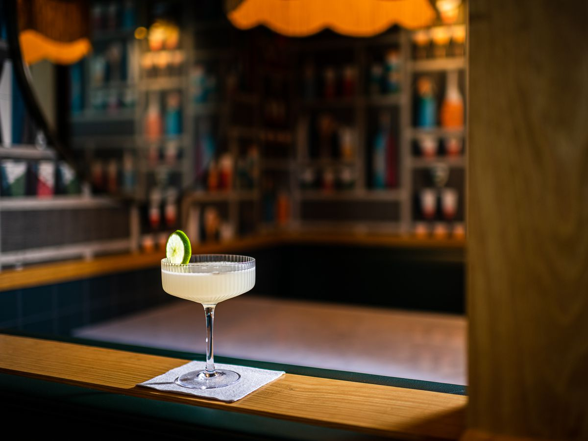 A classic margarita with a lime wheel garnish at Jane Jane