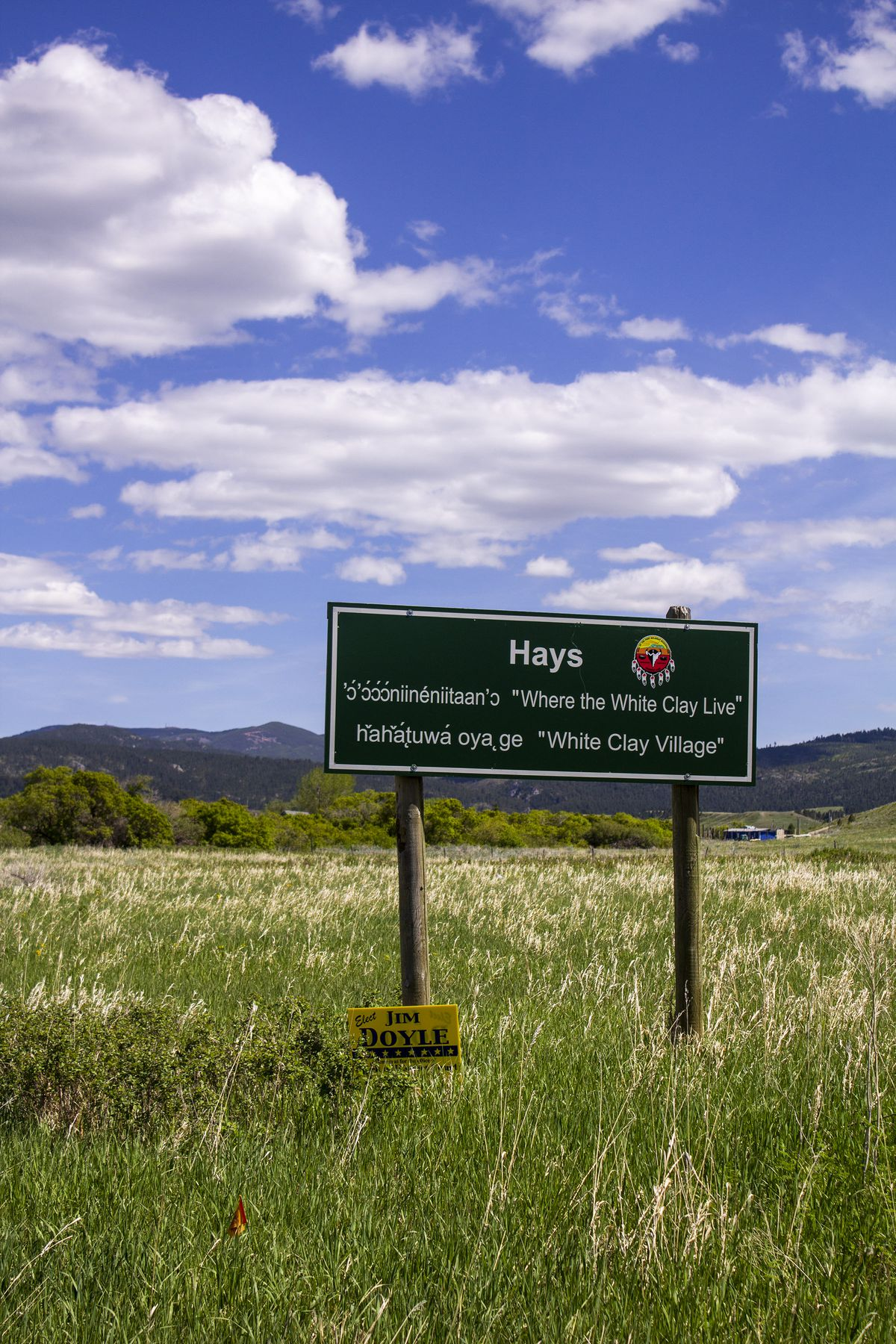 A sign shows the area of Hays, and features the languages of Fort Belknap's two tribes.